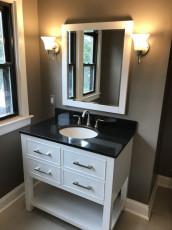 White Vanity with Dark Countertop