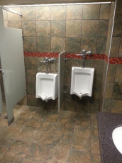 commercial-bath-renovation-tile-urinals
